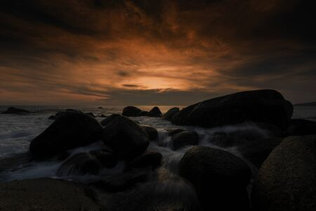 Beautiful Seascape with sea and rock on sunset background. Stock Photo