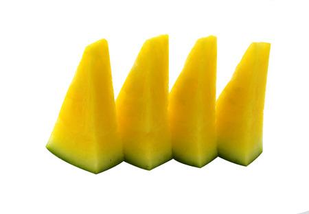 Rebanadas de sand�a amarilla fondo blanco Foto de archivo