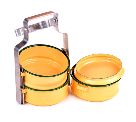the carrier: Yellow metal carrier tiffin, antique thai food carrier