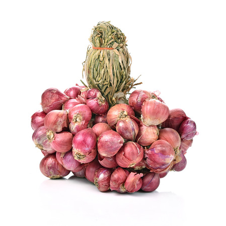 bunch of small thai red onions on white background