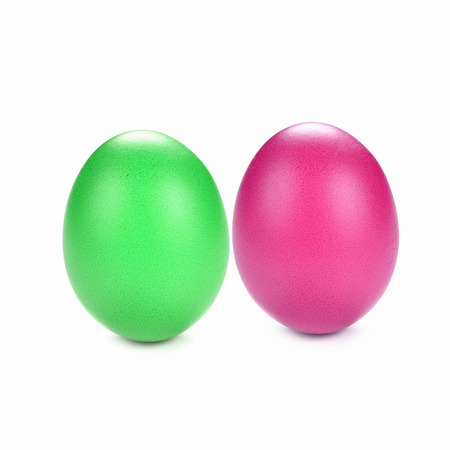dyed green and purple eggs on white background