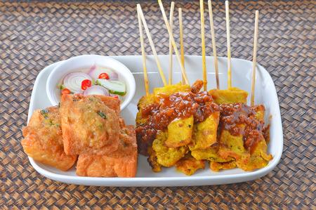 Satay Pork in Peanut Sauce on wooden table, Thai food