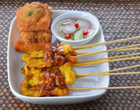 peanut sauce: Satay Pork in Peanut Sauce on wooden table, Thai food