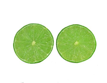 scurvy: Green lemon slice of fresh  on white background