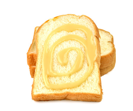 sweetened: Bread, butter, cream, sweetened condensed milk White background