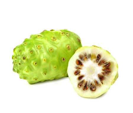 noni: Noni is placed isolated on a white background. Stock Photo