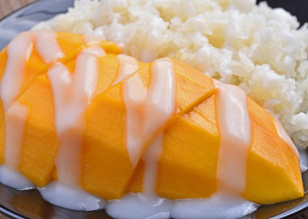 Mango sticky rice topped with coconut milk Stock Photo