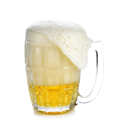 overflowing: Overflowing beer glass, holding a white background