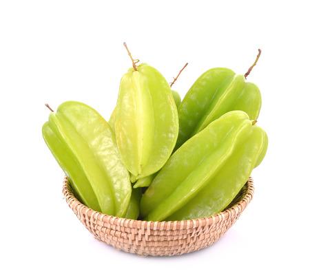 Carambola fruit in basket on white background