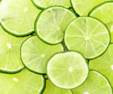 Tranches de citron vert fond Banque d'images