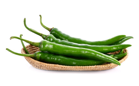 Green chilli pepper in basket on white background