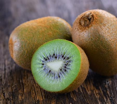 Kiwi Fruits Sliced fresh on Wood Table Background