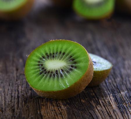 Kiwi Fruits Sliced freshness on Wooden Background