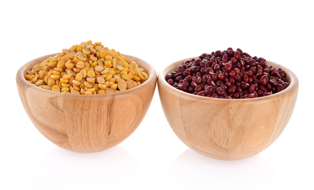 Soy beans, red beans, wooden bowls isolated on white background Stock Photo