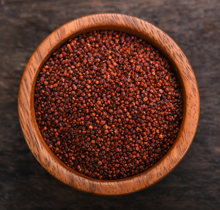 Quinoa in bowl on wooden background. top view