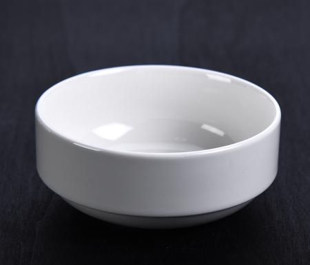 Empty white bowl on black background Stock Photo