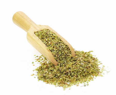 Oregano spice in spoon isolated on white background