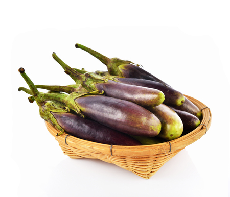 Eggplant in basket isolated on white background