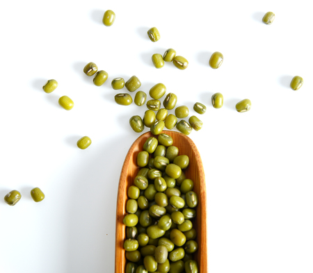 Mung bean in spoon isolated on white background Stock Photo