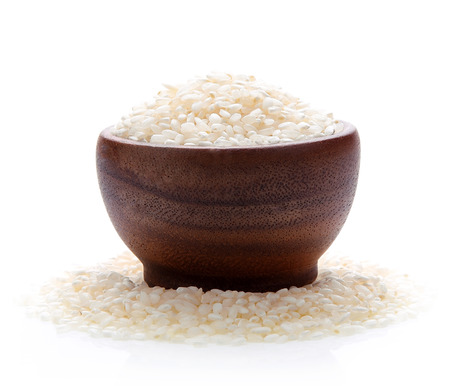Japan rice dry in wood bowl isolated on white background Stock Photo