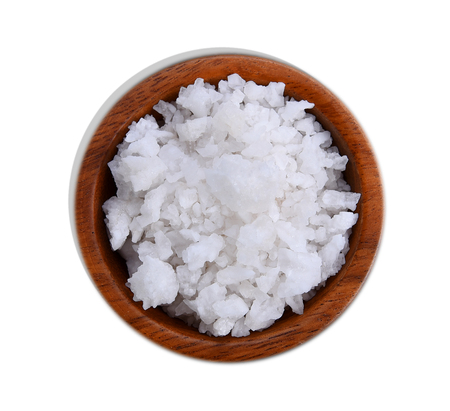 Salt in wood bowl isolated on white background