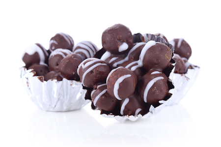 chocolate biscuit: Chocolate cookies biscuit balls with milk and chocolate ganache sauce on white background Stock Photo