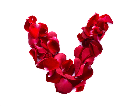 scattered in heart shaped: The letter V in love is written with rose petals. White background.