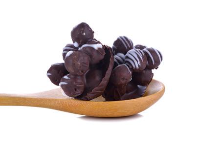 ganache: Chocolate cookies biscuit balls with milk and chocolate ganache sauce on white background Stock Photo