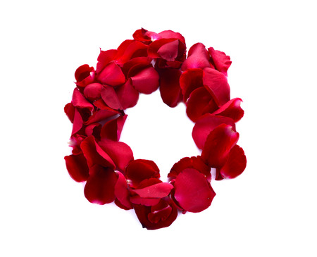 scattered in heart shaped: The letter O in love is written with rose petals. White background.
