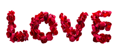 scattered in heart shaped: The word love is written with rose petals on a white background. Stock Photo