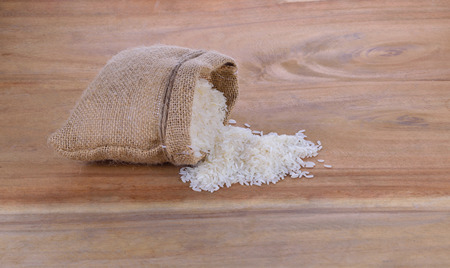 hemp hemp seed: Hemp sack with  rice seed and  rice seed on the  on   wood flooring.