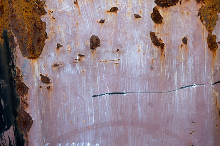 corroded: Corroded white metal background. Rusted red painted metal wall. Stock Photo