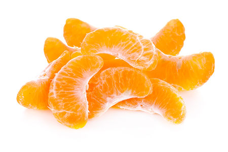 Slice sections of ripe tangerine isolated white background.