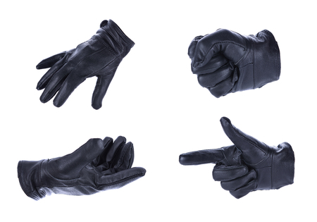 defining: A hand in black leather glove making a shooting gesturing, isolated on white background