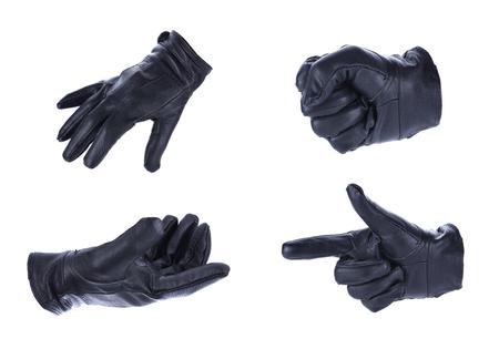 comunicacion no verbal: Una mano en el guante de cuero negro haciendo un tiroteo gestos, aisladas sobre fondo blanco
