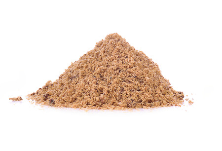 Pile of wooden sawdust and shavings isolated on white
