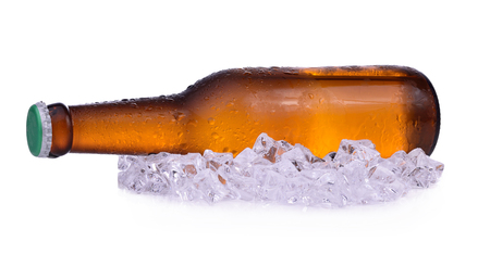 Bottle of beer with drops and ice isolated on white background