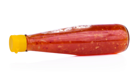 Bottle of spicy, red hot sauce isolated on white background