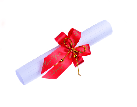 Diploma, close up of paper scroll with red ribbon isolated on white background Stock Photo