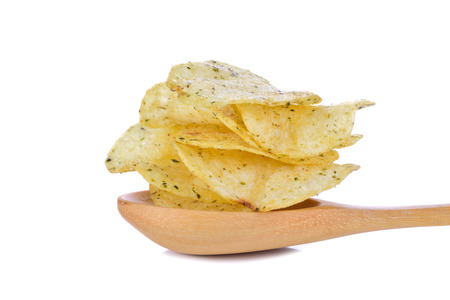 Potato chips  on wooden spoon on a white background.