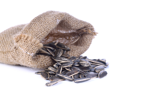 Sunflower seeds in Hemp sack isolated on white background close-up