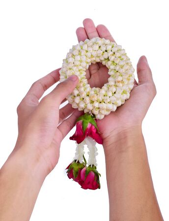 Thai Flower Garland with jasmine & roses on both hands put together as sign of respect & honour (flower garland is widely given on Songkran festival & Mother's day in Thailand) isolated on white