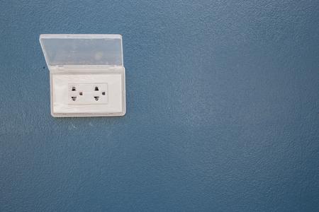 plugged: blue wall and socket plug