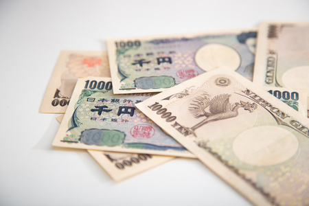 yen: Japanese yen banknotes white background