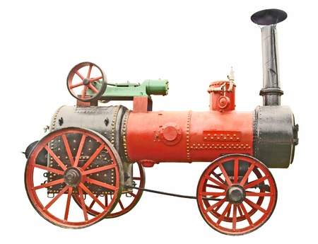 farm machinery: Antique steam tractor isolated on white background Stock Photo