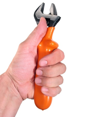adaptable: Hand grasping a wrench and making the thumb up sign, isolated on white background Stock Photo
