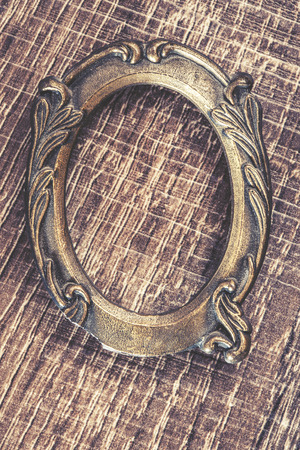 cross processed: Vintage frame on a wooden background. Cross processed image