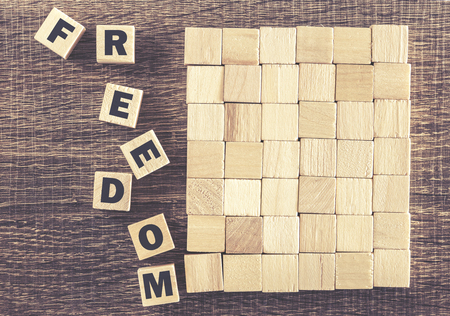 alphabet wallpaper: Freedom message. Cross processed image for vintage look