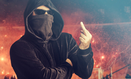Angry hooligan showing the middle finger. Stock Photo