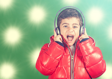 reacts: Boy reacts while listening to music.